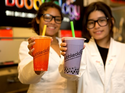 Bubbleology Franchise - Twp Employees holding drinks
