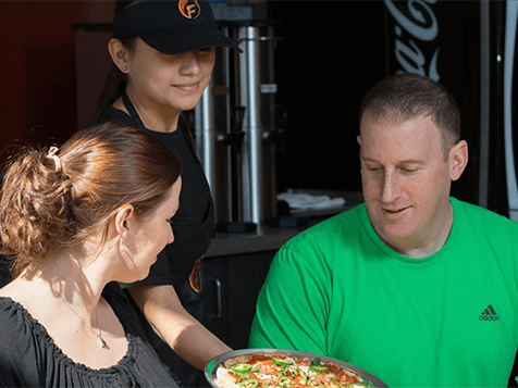 Happy Customers at a Firenza Pizza Franchise