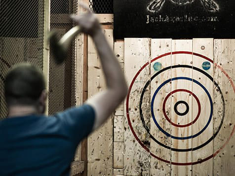 Throwing axes at a HaliMac Axe Throwing Franchise