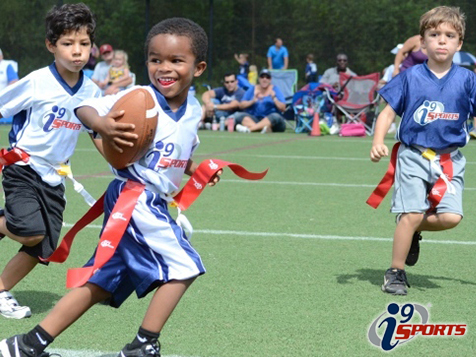 kids enjoying football through the i9 Sports franchise