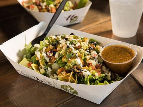 Burrito Shak Franchise salad with baja dressing