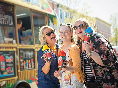 Kona Ice Franchise Customers with Shaved Ice