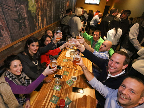 Happy customers at a Growler USA Franchise