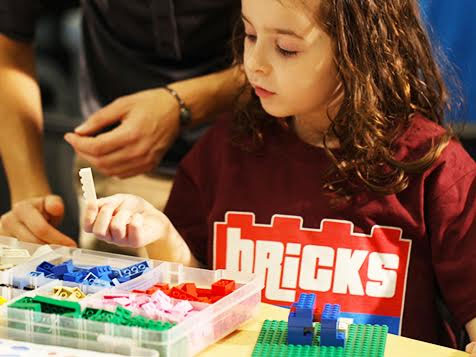 Bricks 4 Kidz - Girl having fun with legos