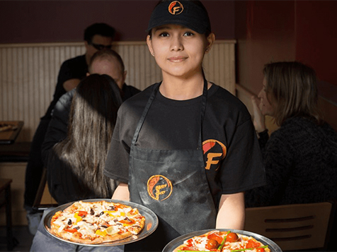 Serving Pizza at a Firenza Pizza Franchise